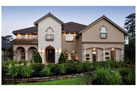 Stone accents stucco arches and a rustic tile roof impart for Stucco homes with stone accents