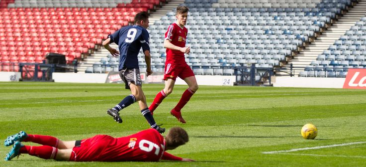 Queen's Park's Ewan MacPherson scores during the Ladbrokes League One game between Queen's Park and Albion Rovers.