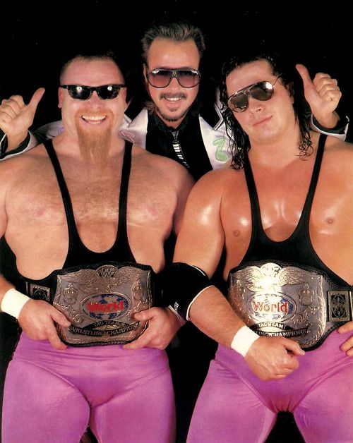 WWF World Tag Team Champions The Hart Foundation - Bret Hart and Jim Neidhart with Jimmy Hart