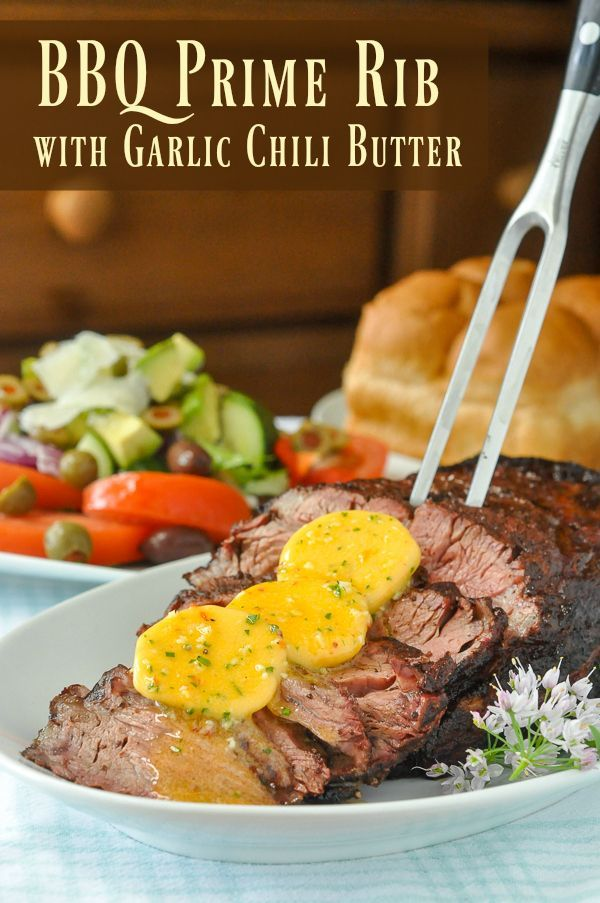 BBQ Prime Rib with Garlic Chili Butter - a dry spice rubbed prime rib roast gets…
