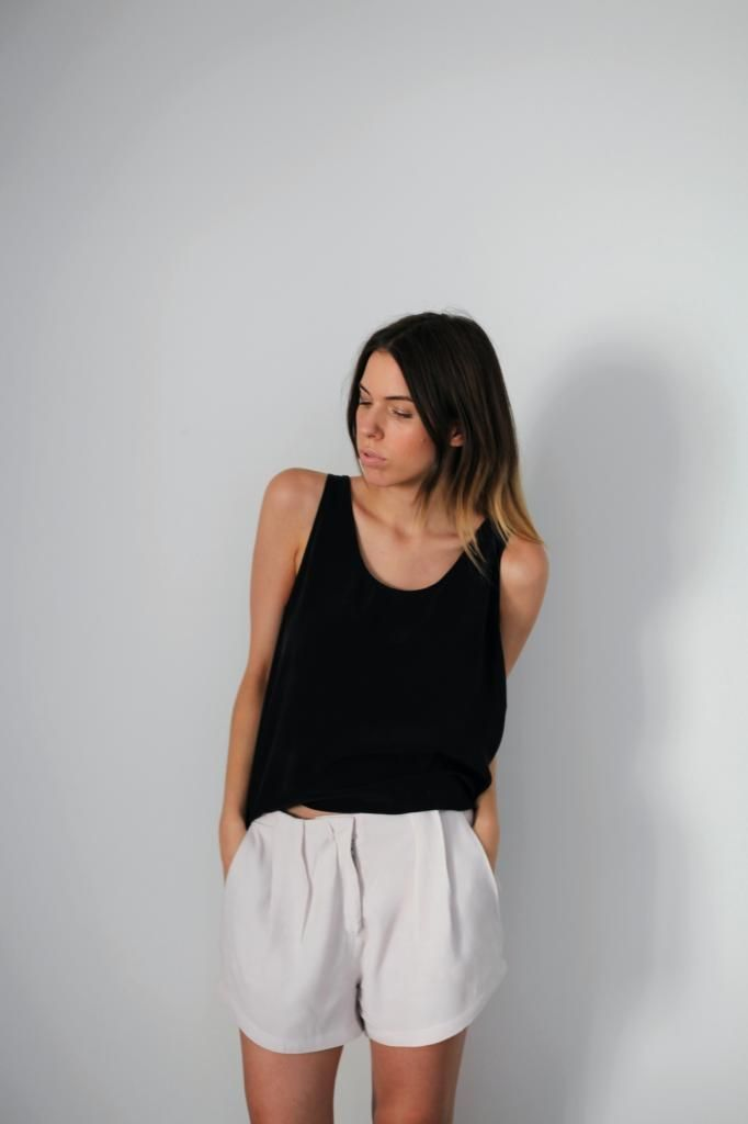 Minimal + Classic: black tank and pleated loose white shorts