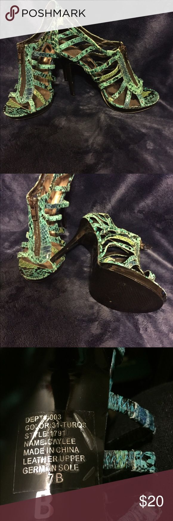 Turquoise snake print spike heels Fun turquoise snake printzip front spike heel shoes. Size 7.  Worn once or twice for a party. Make me an offer or bundle up 🎉💖🎉💖🎉💖 Bakers Shoes Platforms