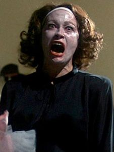 "In this scene from ""Mommie Dearest,"" the robe on Faye Dunaway as Joan Crawford seems as menacing as she is."