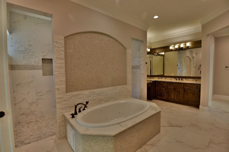 Loving this master bathroom installation out of houston for Tile flooring houston
