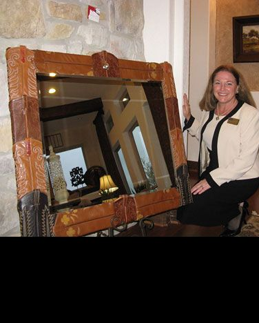 This lady used old cowboy boot tops and wood to build an amazing, cute, funky mirror!