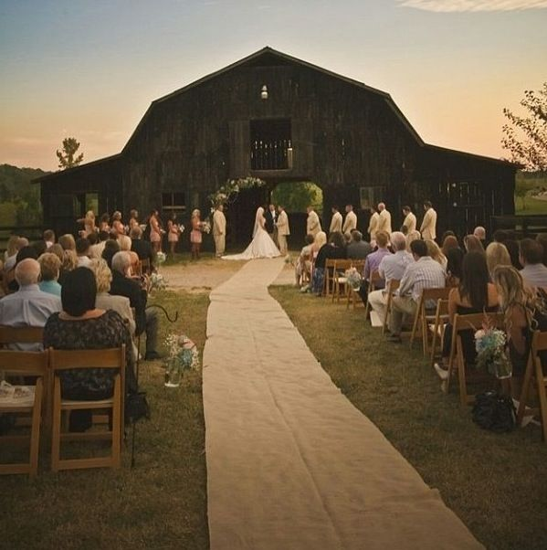 A ceremony in front of the barn--wonderful.  Our barn at the Apple Tree Lane Bed  Breakfast, Waupaca, WI, is a red barn, but is a beautiful backdrop.  www.appletreelanebb.com