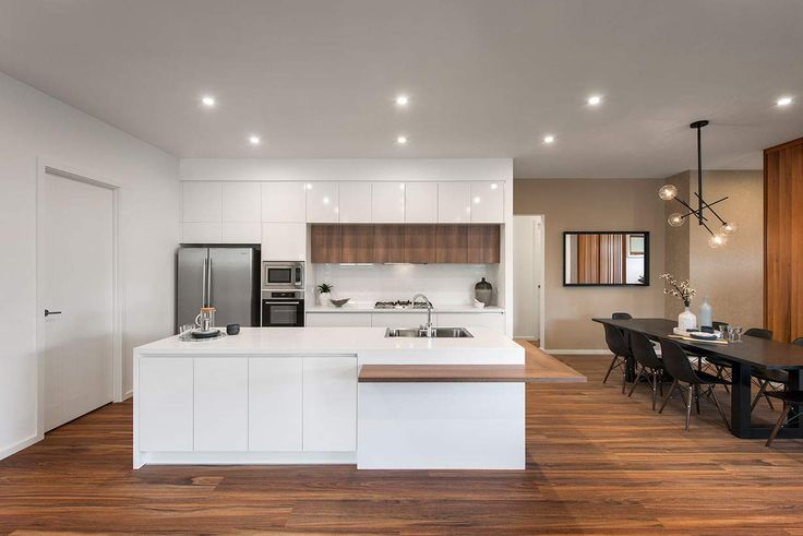 A charming dining area sits alongside the beautiful kitchen #weeksbuildinggroup #newhome #homedesign