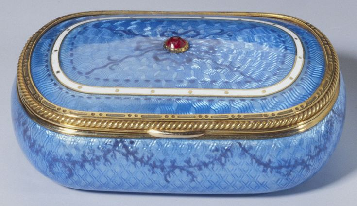 Fabergé box, 1896 - 1908, gold, silver-gilt, guilloché enamel, cabochon ruby, 2 x 5.3 x 3 cm, In the Royal Collection by 1953, Rounded rectangular gold, silver-gilt and pale blue guilloché enamel box, cover set with central cabochon ruby within tooled gold bead and reel and rope twist borders with an inner white enamel band. Enamelled ribbons and swags on cover.
