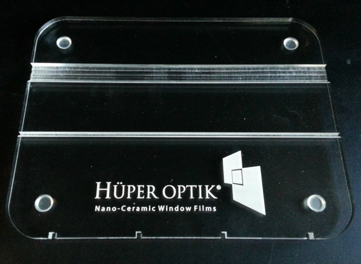 """The Acrylic Base with Huper Optik Logo makes HEAT SHEET demonstrations easy by allowing you to remain 'hands free' while demonstrating the heat blocking effectiveness of performance glass and window films. Measures 8x10"""" Buy it here $30.00"""