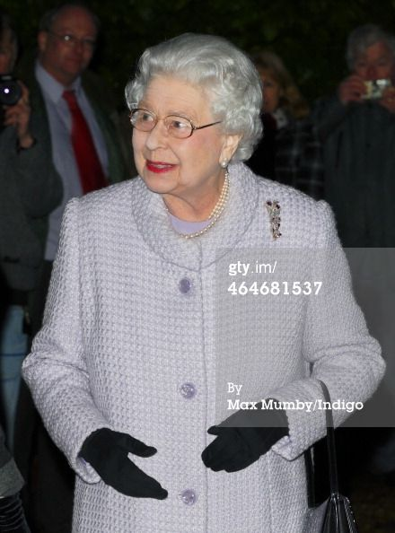 (EMBARGOED FOR PUBLICATION IN UK NEWSPAPERS UNTIL 48 HOURS AFTER CREATE DATE AND TIME) Queen Elizabeth II leaves after attending a meeting of the Sandringham branch of the Women's Institute, of which she is President, at West Newton Village Hall on January 23, 2014 near King's Lynn, England. The guest speaker at the meeting was Bill Turnbull, presenter of the BBC One Breakfast Show. (Photo by Max Mumby/Indigo/Getty Images)