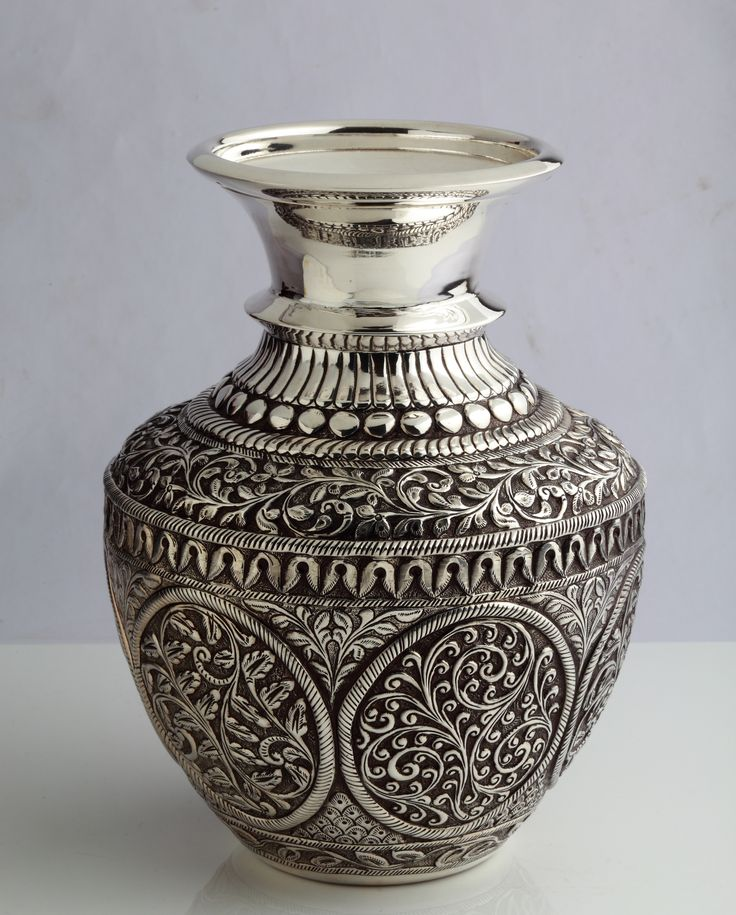 Intricately designed silver pot...