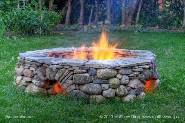 This ring of fire was built by Matthew Ring [www.matthewring.ca] in Guelph, Ontario, Canada using only stone, no cement. The star-burst roman arches allow air to fuel the flames. More, including video, at www.naturalhomes.org/timeline/ringoffire.htm