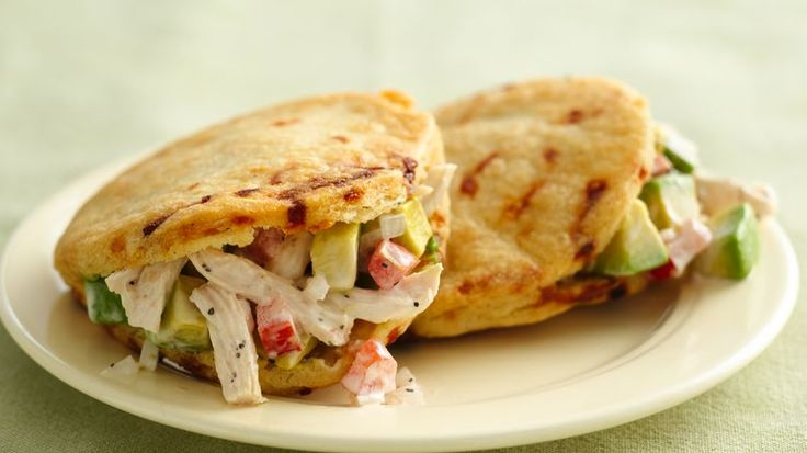 Enjoy these delicious arepas that are filled with chicken – a wonderful dinner.