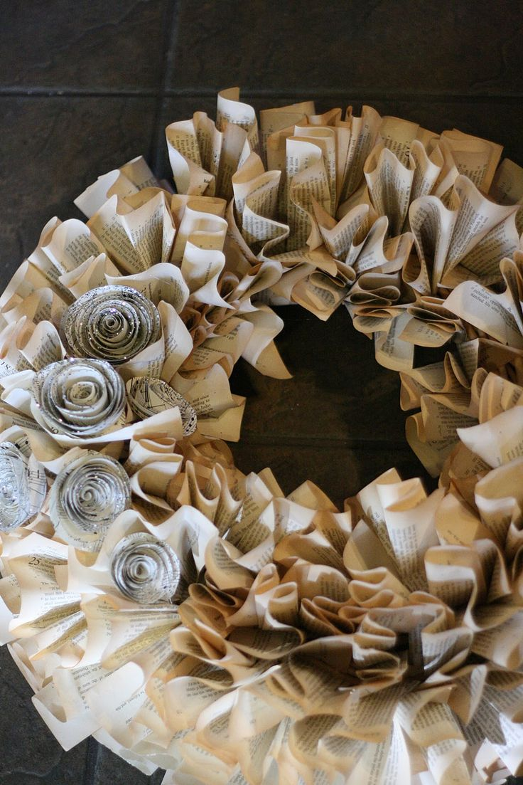 25 Book Page Wreath Tutorials - I made the one in the picture minus the  flowers. I cut a wreath shape out of cardboard and used a book from  Goodwill.