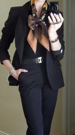 A classic work outfit (interview appropriate) - black pants suit, black top, brown/neutral Hermes scarf.