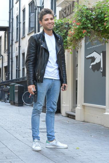Wearing light wash jeans with Adidas stan smith trainers, a white t-shirt  and a black leather biker jacket for simple casual style