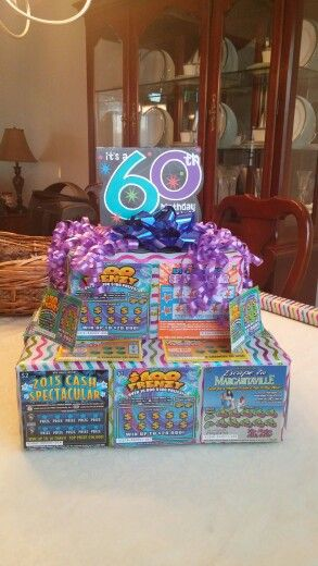 Lottery ticket cake... Super easy to make and a big hit! I used 2 boxes...  wrapped them in decorative paper then taped them together. Use tape to attach the lottery tickets to the boxes then add bows and a topper!