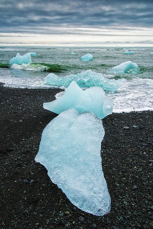 Icy Iceland Art Print. Cool turquoise ice pieces lying on the black beach. Jokulsarlon Glacier lagoon, Iceland. Available as poster, framed print, metal, acrylic, wood or canvas print. Art for your Home Decor and Interior Design by Matthias Hauser.