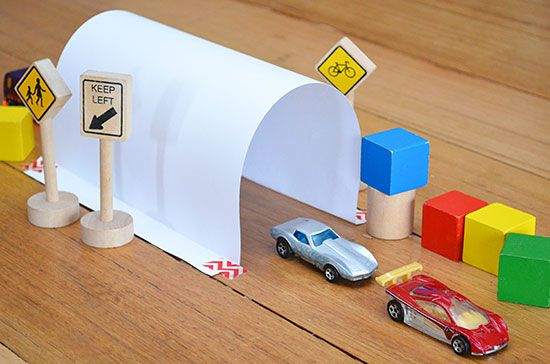 Childhood 101   6 Ways to Play with Toy Cars Make a Tunnel Make a simple tunnel by folding the short edges of a piece of A4 (or letter sized) paper over about a centimetre. Tape one of the folded edges to the floor and then gently roll the paper into a tunnel shape and tape the other folded edge to the floor. -