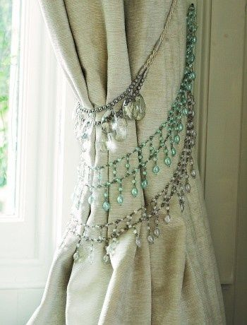 Add bejeweled accents, like these crystal necklaces used as curtain tiebacks. - Maybe use a side curtain as a ceiling-to-floor headboard! DIY & cheap!!