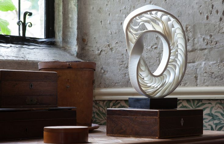 Porcelain Mobius sculpture on African ebony