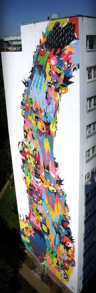 Graffiti/Mural on a building, looks sorta like a splash. Very colorful  I like it
