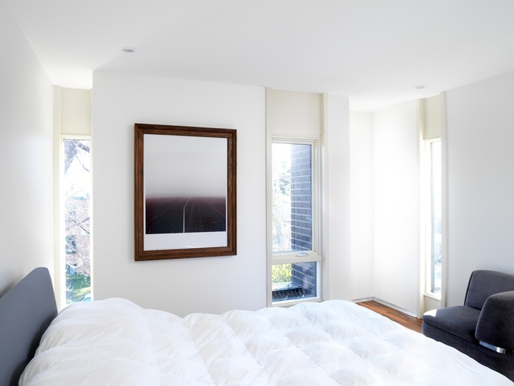master bedroom in the hannon richards 16th street residence located in bankview, calgary / a modernist space that purposefully avoids suburban stereotypes, interiors intermittently get lighter as one ascends the home / residential / davignon martin architecture + interior design