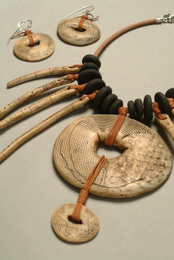 Necklace & Earrings | Luann Udell. Luann is a fiber, polymer and mixed media artist, who recreates old artifacts using polymer clay. This necklace is a great example, where her own handmade pieces are made to look like real fossil ivory.