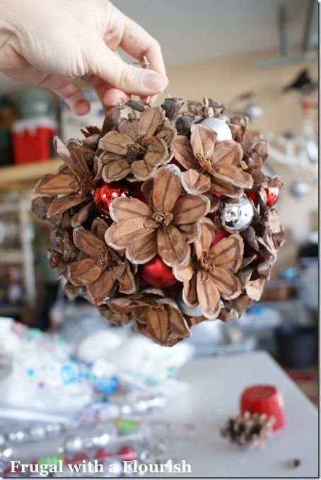 Pinecone Kissing Ball: Cut little layers off pinecone to produce pine flowers.  Not as difficult as it looks.