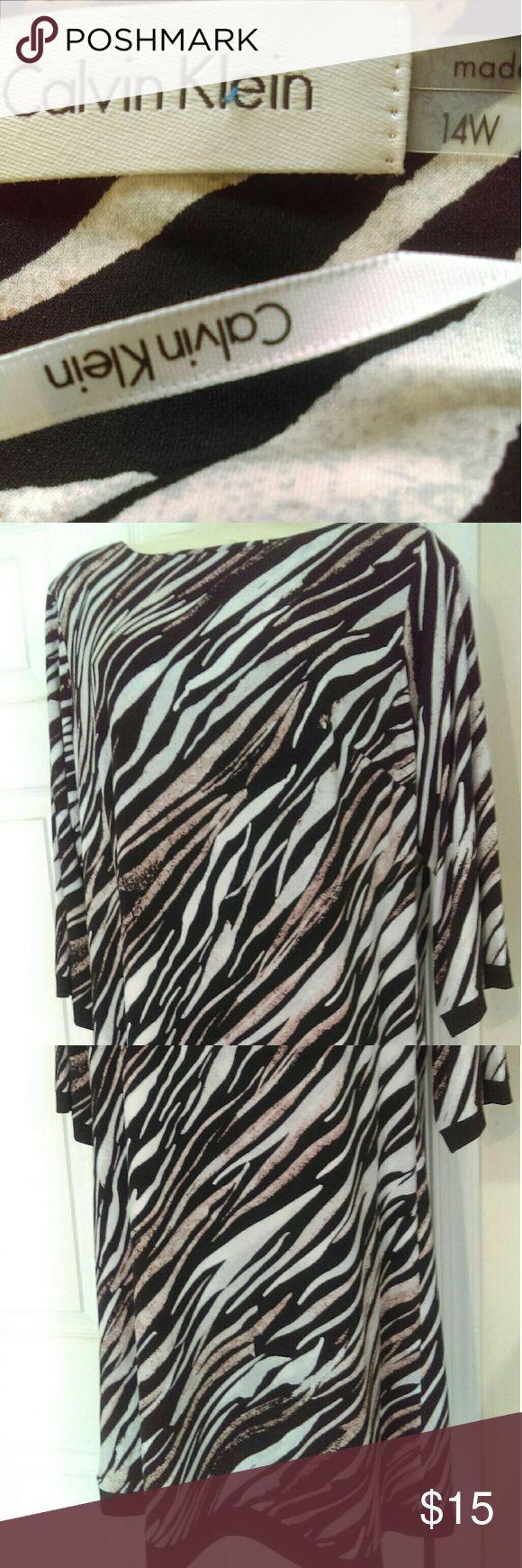 Calvin Klein pullover animal print dress Banded bottom hemline, polyester/spandex, never worn Calvin Klein Dresses Midi