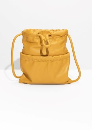 & Other Stories image 1 of Drawstring Leather Shoulder Bag in Yellow