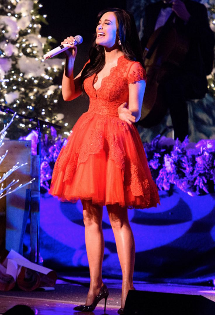 Two-time Grammy Award winning singer Kacey Musgraves wore a dress by Mac Duggal (Style #48341) while performing on her 'A Very Kacey Christmas' Tour at New York City Town Hall in New York, New York on December 8, 2016.