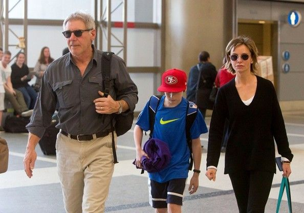 Calista Flockhart Photos - Harrison Ford, Calista Flockhart, and their son Liam Ford prepare to depart LAX (Los Angeles International Airport). - Harrison Ford and Family at LAX