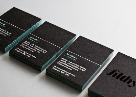 Nice accent color on these business cards, achieved by gluing the black paper stock to the front and back of the blue paper stock.