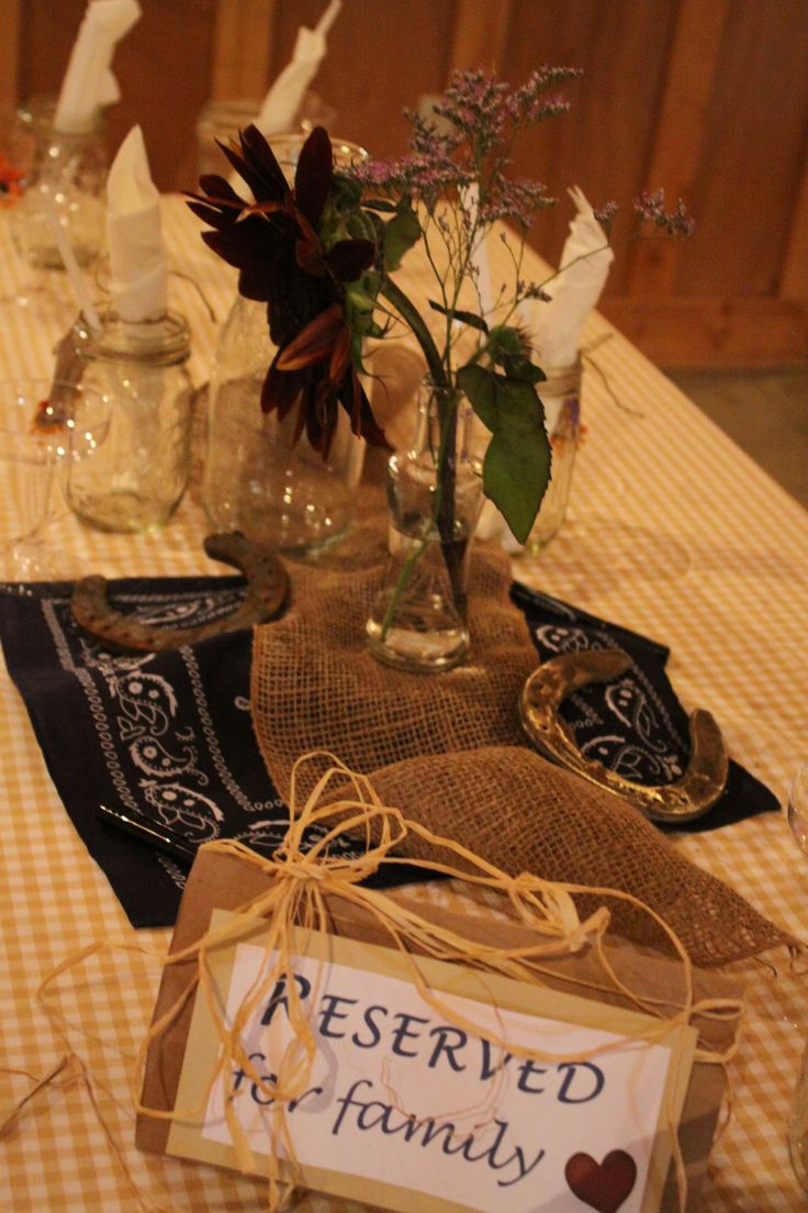 Our wedding table decor rustic horseshoes blue bandana for Wedding decorations for tables centerpieces