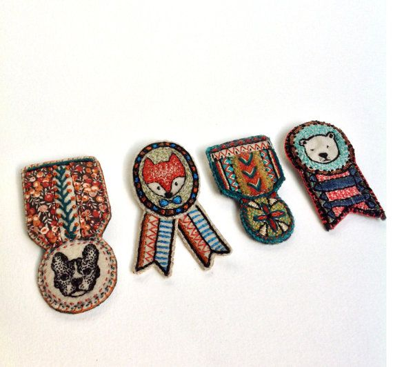 Hand embroidered medal brooches by Creamente!