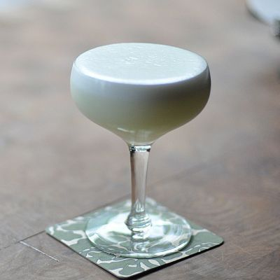 The White Lady has a lot of similarities to a Sidecar - the key difference being the main ingredient, gin rather than brandy.