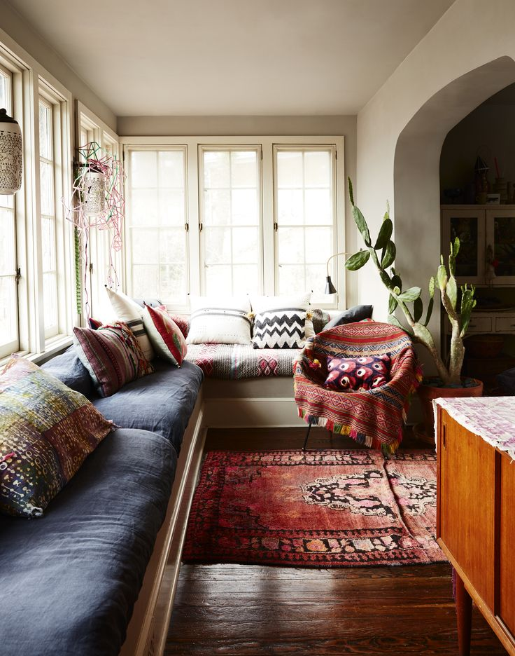 Sunroom with window seats in Liva Cetti and Danny Marrone's Spanish Mediterranean house remodel in the Bronx, photo by Kate Mathis |Remodelista
