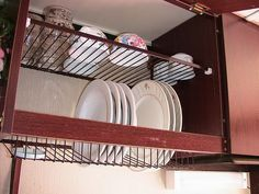 Tiskikaappi.  Finnish kitchen cabinet dish drying rack.  The dish rack is just simple wire rack, with open bottom of the cabinet, and you can lift all the hand washed dishes inside the cabinet to drip down to the sink. This leaves more space to your counter and your dishes are hidden behind the cabinet.
