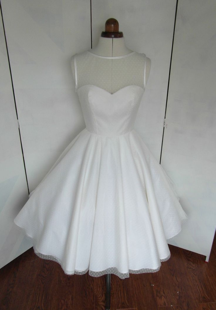 The Dotty tea length wedding dress by RyleyandFlynnVintage on Etsy https://www.etsy.com/listing/211376920/the-dotty-tea-length-wedding-dress