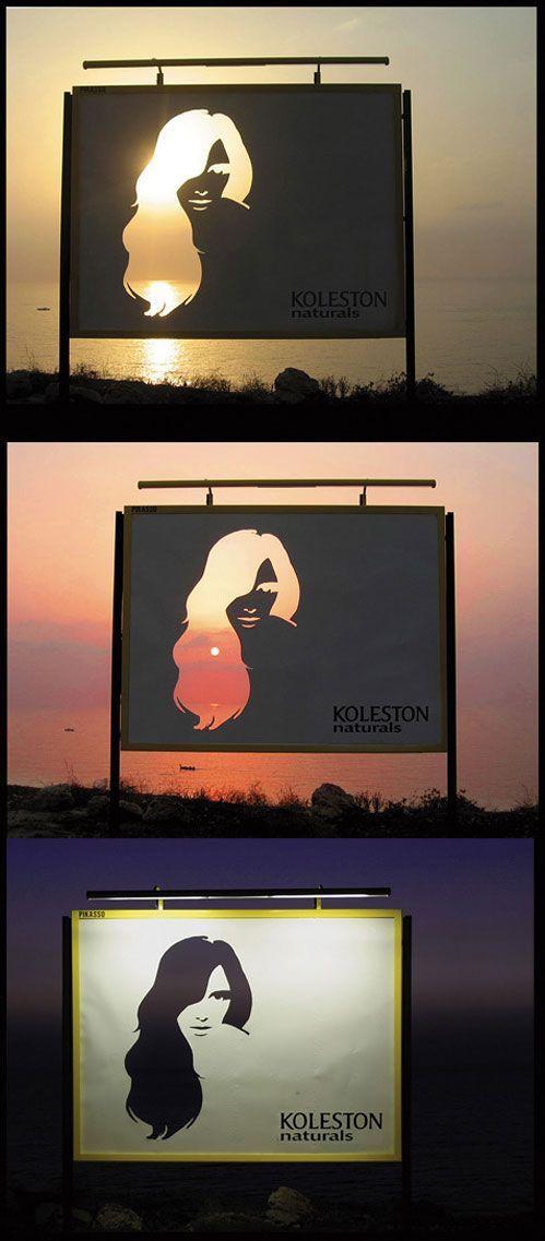 "Kolestron土黃:更改。 ""這個戶外執行了戰略定位上散步。 它有大海和天際線背後的未受污染的看法。 女人的頭髮模切在廣告牌經過一天一夜的不同階段捕捉Kolestron的土黃""顏色變化"":"