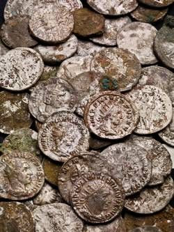 Beau Street Hoard, a huge hoard of silver coins found by archaeologistss working just 150 metres from the Roman Baths, UK it's one of the largest hoards ever found in Britain. 270AD, more than 30.000 coins