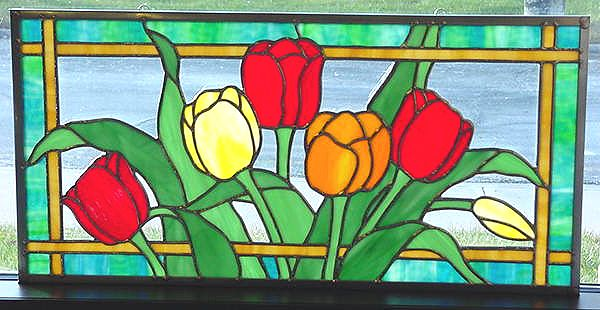 Bright Oldani Tulips Stained Glass (I like the way the foliage seems to flirt with the woven border.)
