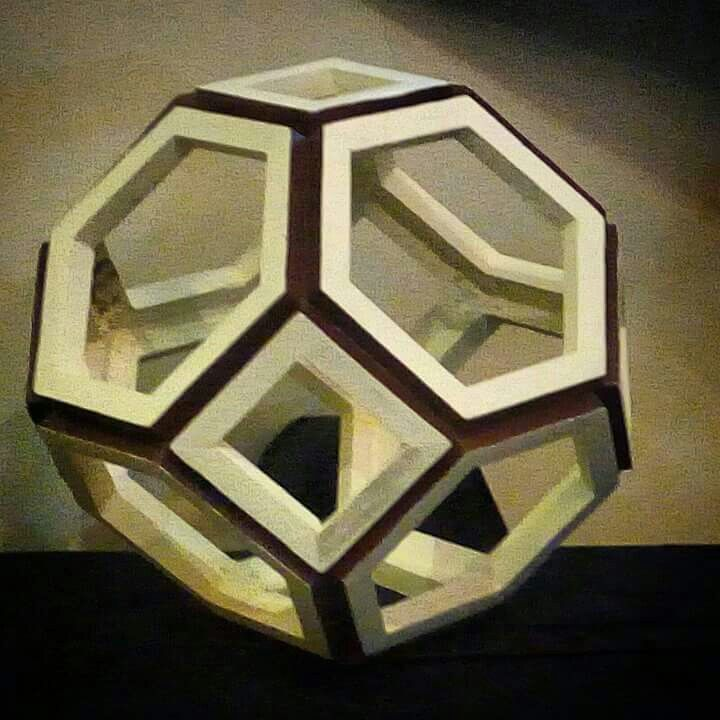 """FROM PAPER TO WOOD  Polyhedron # 8 - TRUNCATED OCTAHEDRON  Designed by Leo R. Natividad for Ligjts & Folds Handicraft Fabricated by Allan Aguinaldo  Using 3/4""""×3/4""""×4.5"""" Softwood 6 Squares 8 Hexagons  14 Surfaces  24 Apexes  36 Edges  Circumference - 48"""" (121.92 cm) Diameter - 15.28"""" (38.81 cm)  Price - Php 3,693.75  #from_paper_to_wood #only_in_the_world #origamipilipinas #lights_and_folds_handicraft #only_in_the_Philippines #origami_inspired_wooden_polyhedron"""