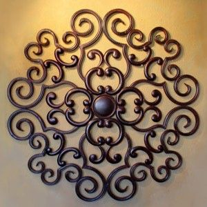 Wrought Iron...Hobby Lobby has a lot of wall designs like this. Spanish wall  decor