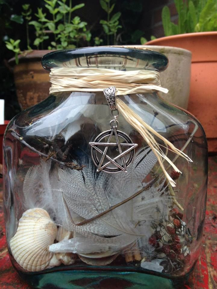Witches bottle, with seashells, iron nails, feathers, real crystals and cinnamon for good luck, small branches and thorns of Hawthorne for protection.