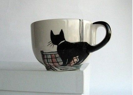yes to the kitty mug...a must for cat lovers, would like to get this