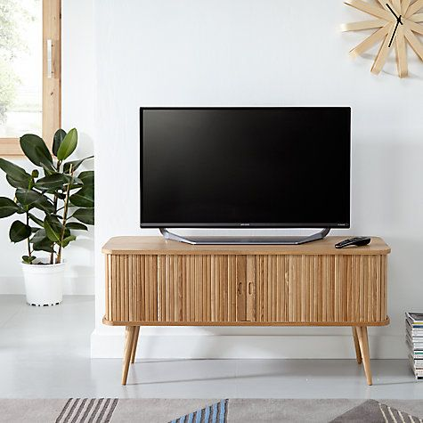 Our Grayson media unit is made from ash wood solids and veneers, and makes a statement in any living room. It will look great as the base for a modern television.