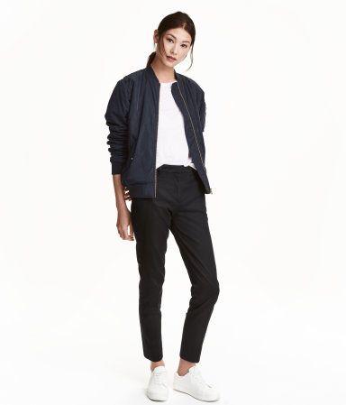 Black. Ankle-length slacks in stretch cotton satin. Regular waist with concealed hook-and-eye fastener, side pockets, and a welt back pocket. Tapered legs.
