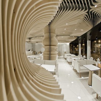 Graffiti Cafe interior by studio MODE - the wood looks amazing!